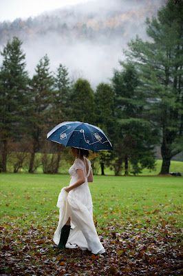 Riverside Farm: The bride in boots doesn't mind the rain     Susan Stripling Photography
