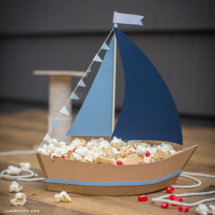 Photo of Ship Party Snacks with This DIY Paper Sailboat Centerpiece!