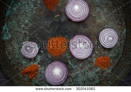Onion rings with slice on rusty plate - stock photo