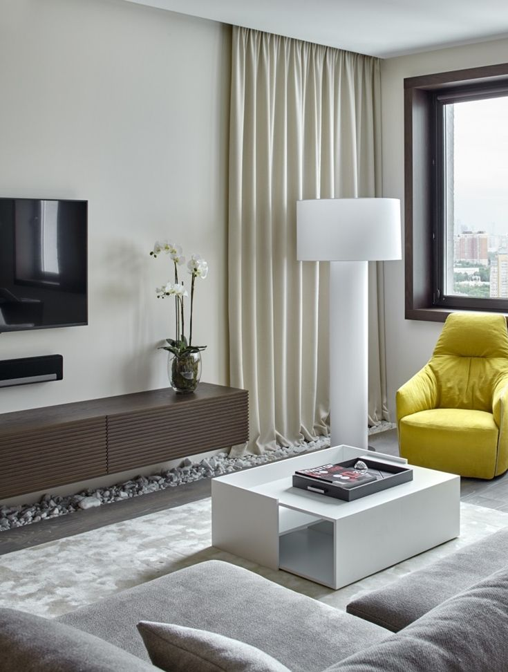 Contemporary Design At Its Finest In A Small Swanky Urban Apartment Small Living Room Design Small Living Room Chairs Living Room Designs Decorative stones for living room