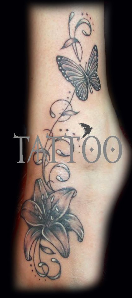 3f0b7117817ce lily and butterfly foot tattoo | tattoo ideas | Butterfly foot ...