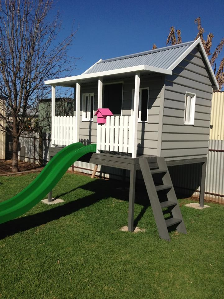 Make a platform for a playhouse and add a slide and porch for Boys outdoor playhouse