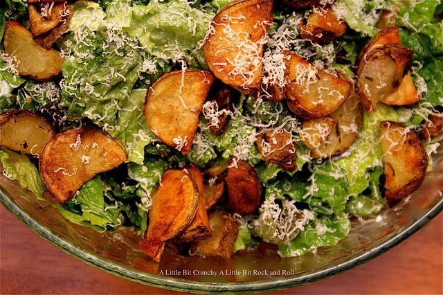 Roasted potatoes with olive oil and rosemary make the perfect topping for this delicious salad tossed with a creamy lemon garlic dressing and freshly grated parmesan cheese.  Full recipe over @RecipeLion