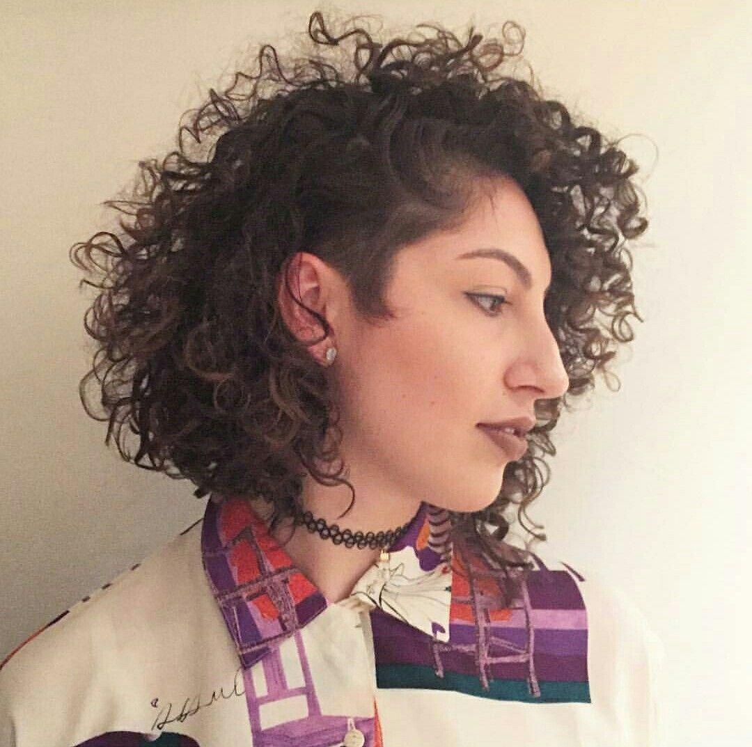 curly hair sidecut; curly sidecut; curly asymmetrical bob; curly bob