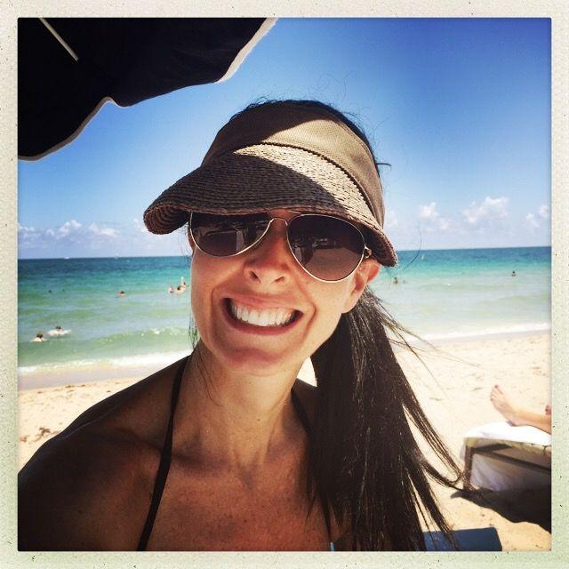 Dr. Emery LOVES smiling...she LOVES the beach!!