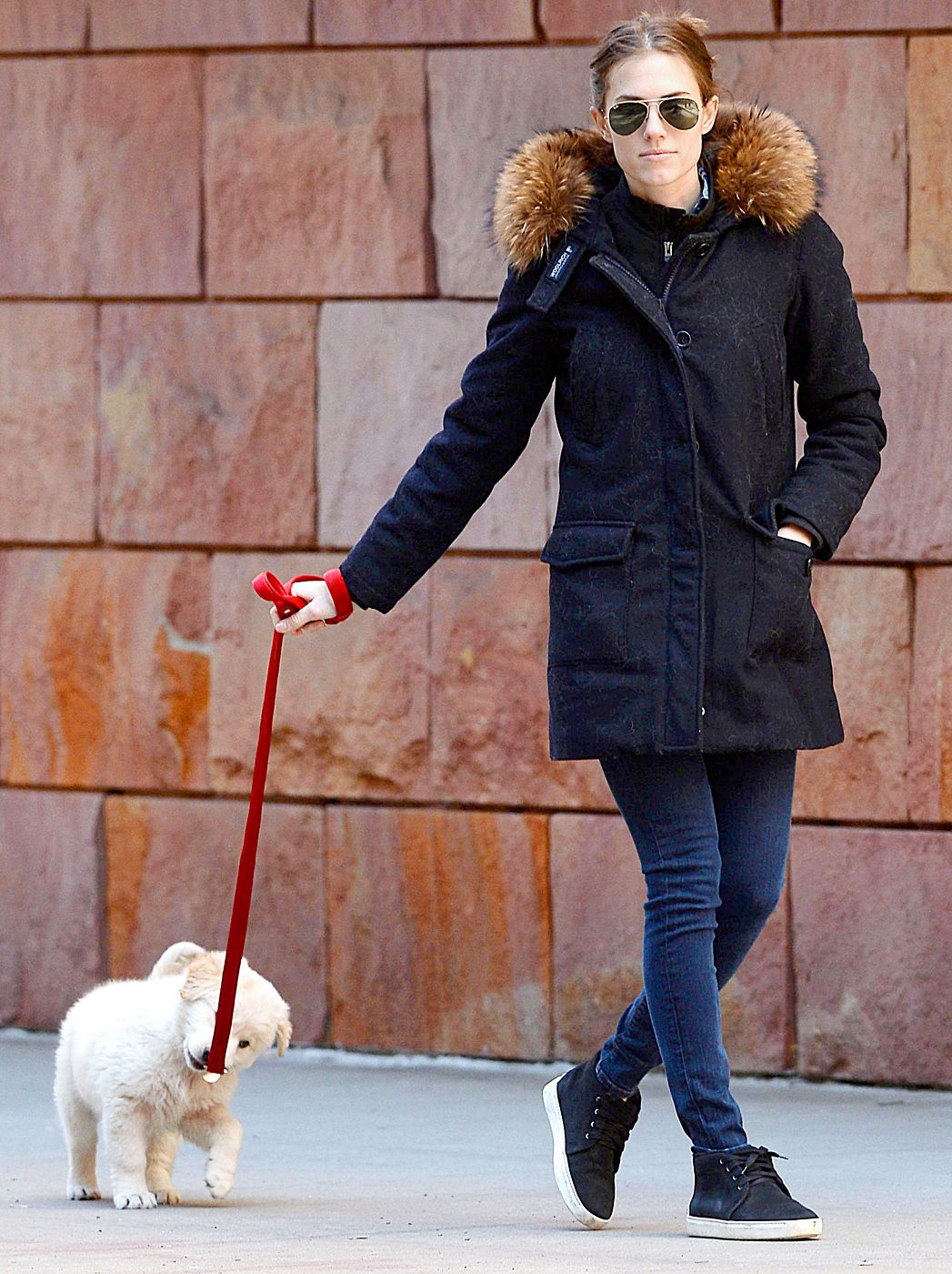 Allison Williams (and her dog) walking through Chelsea
