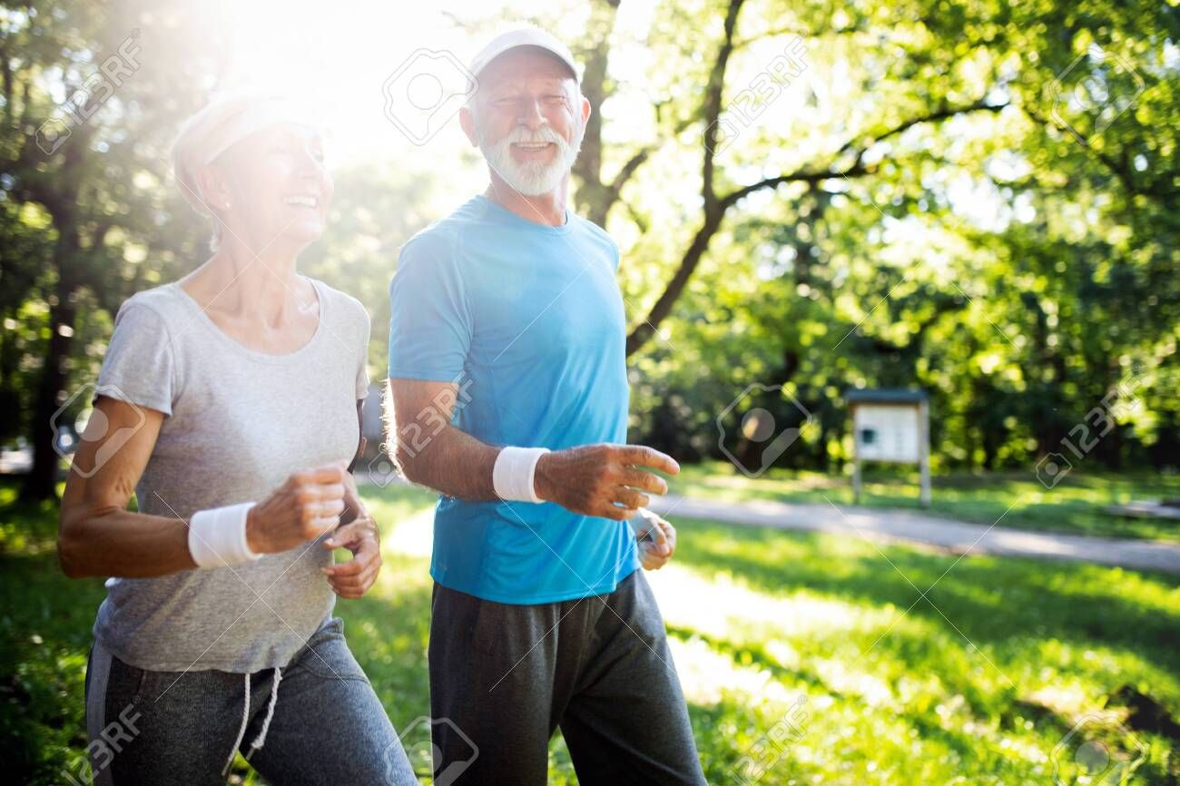 Fitness, sport, people, exercising and lifestyle concept - senior couple running , #ad, #people, #ex...