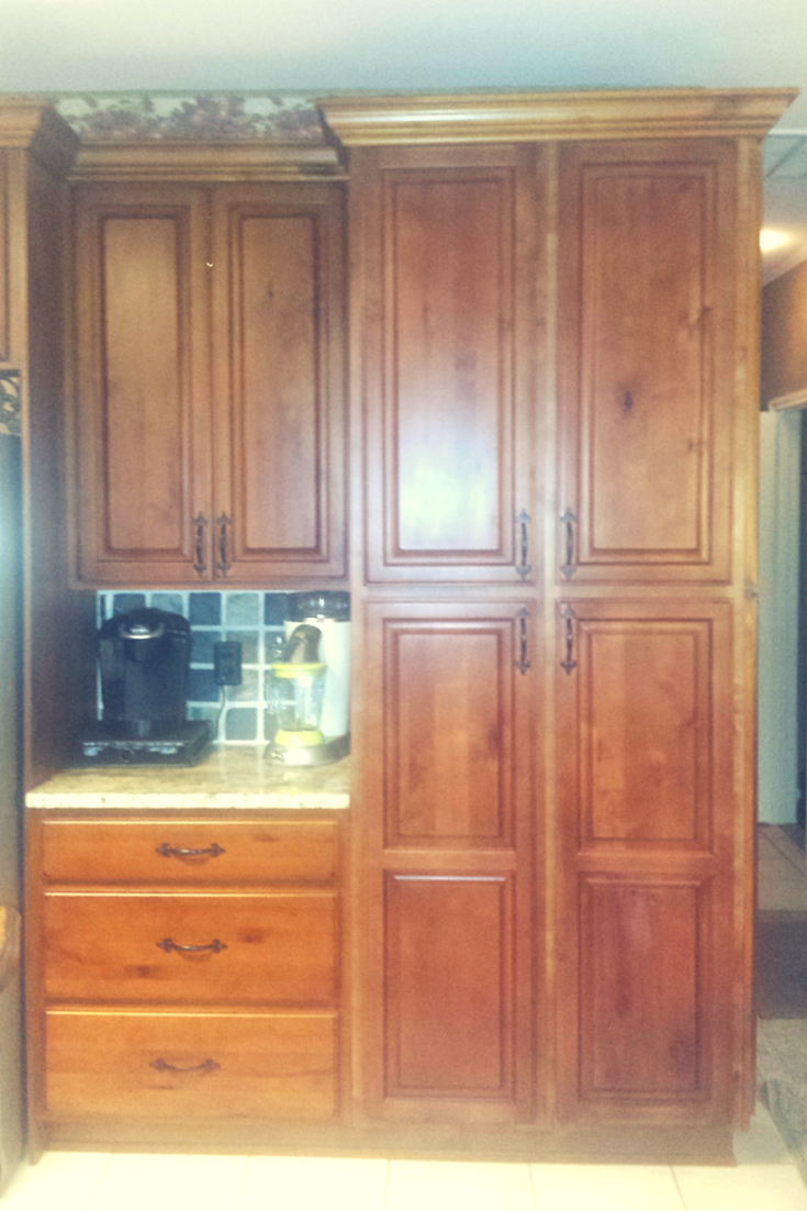 This is a shot of stacy domingueus dark glazed kitchen cabinets