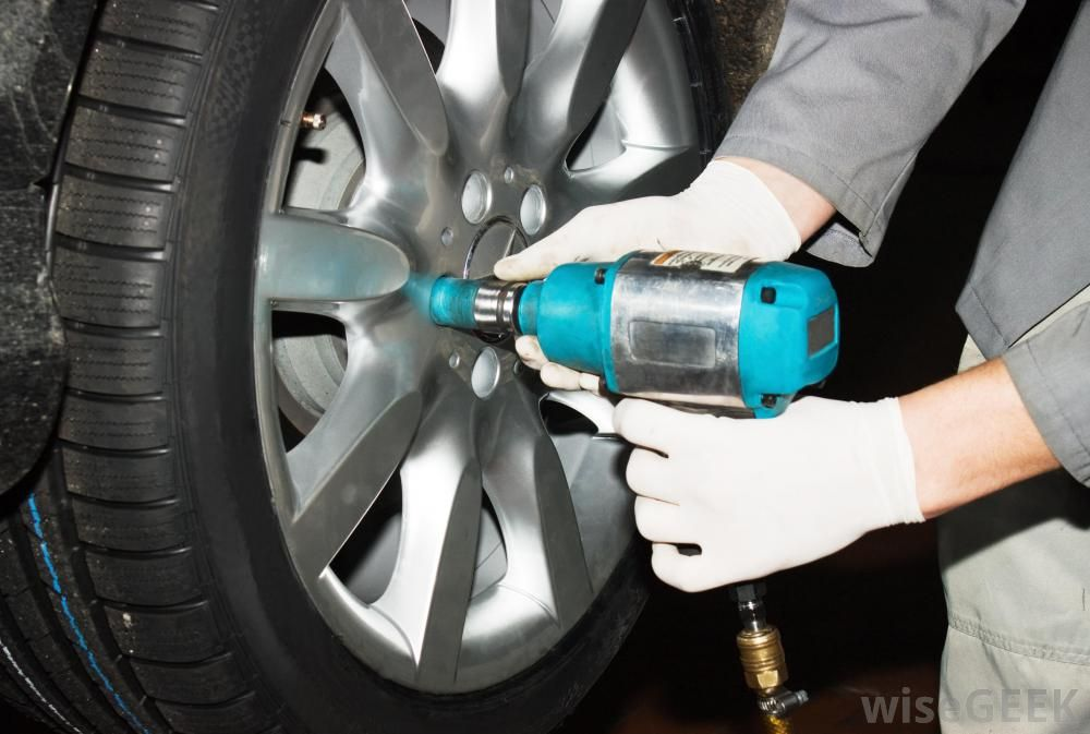 Removing tire from car Image source