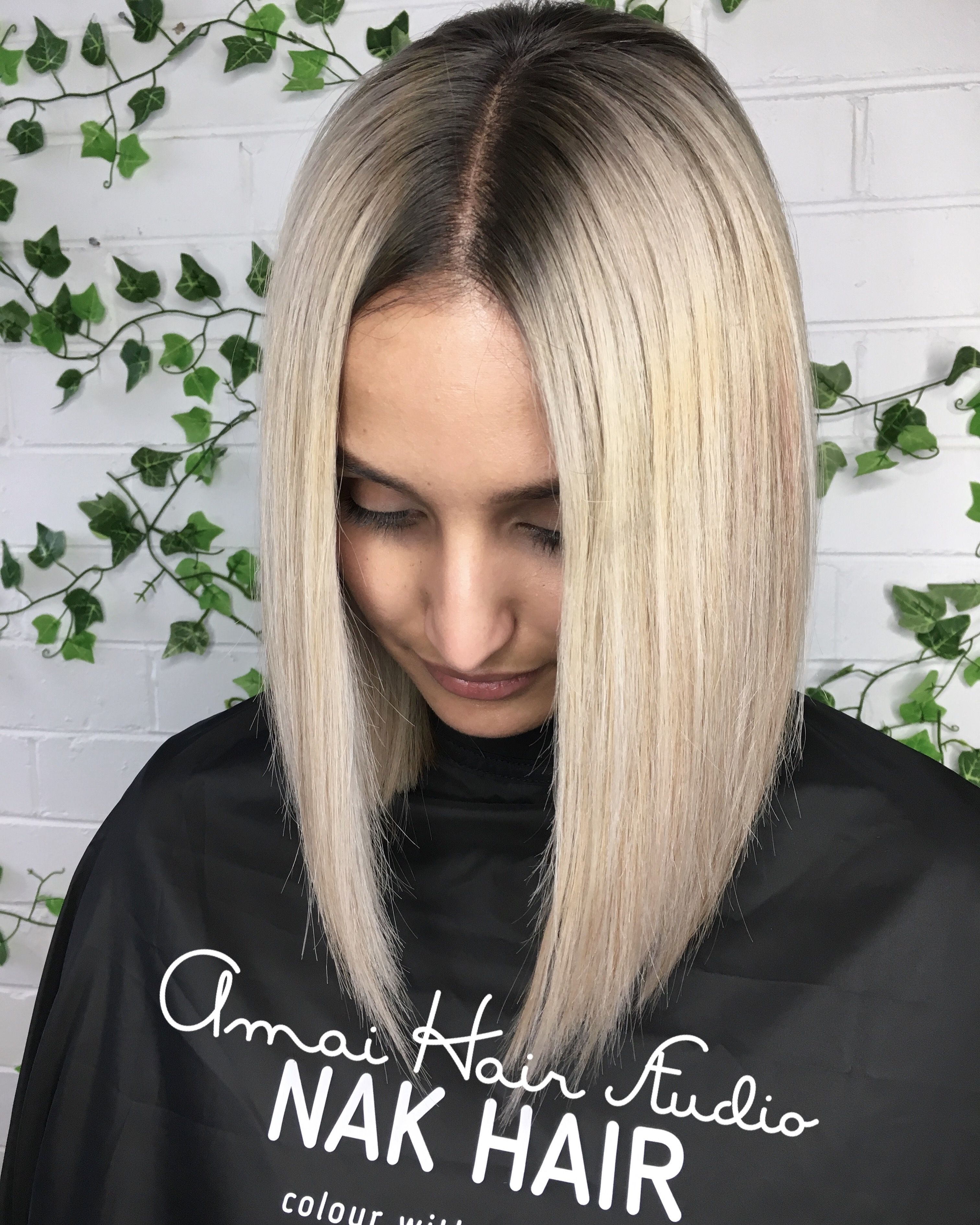 Platinum Blonde Hair With An Ash Shadow Root On Natural Black Hair
