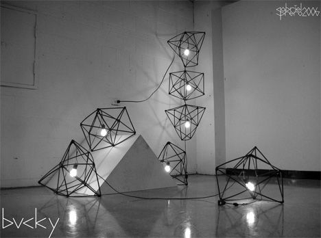 Bucky's objective was to construct a sustainable household item from found materials. The cages are constructed of 102 tubes that formerly housed 102 glow sticks, nearly 100 wire hangers, telephone wire and electrical tape. The lighting is compromised of approx 30′ of lamp wire and standard light fixtures.