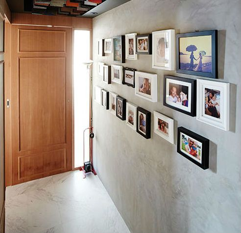 How To Hang Pictures On Your Concrete Wall Concrete Wall Home Comforts Hanging Pictures