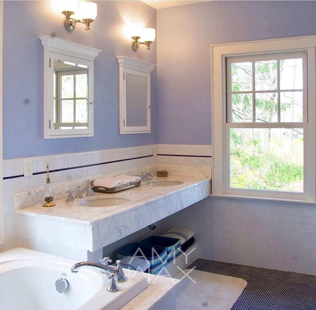 Sharing a bathroom I selected #colors for with a clean and airy approach. Working with a variety of marble colors and contrasting floor #tiles, I chose a delicate periwinkle #blue which the homeowner loved. The #color accentuated the undertones of both the stone and tile . This master bathroom starts and ends every day with a bit of sweetness.