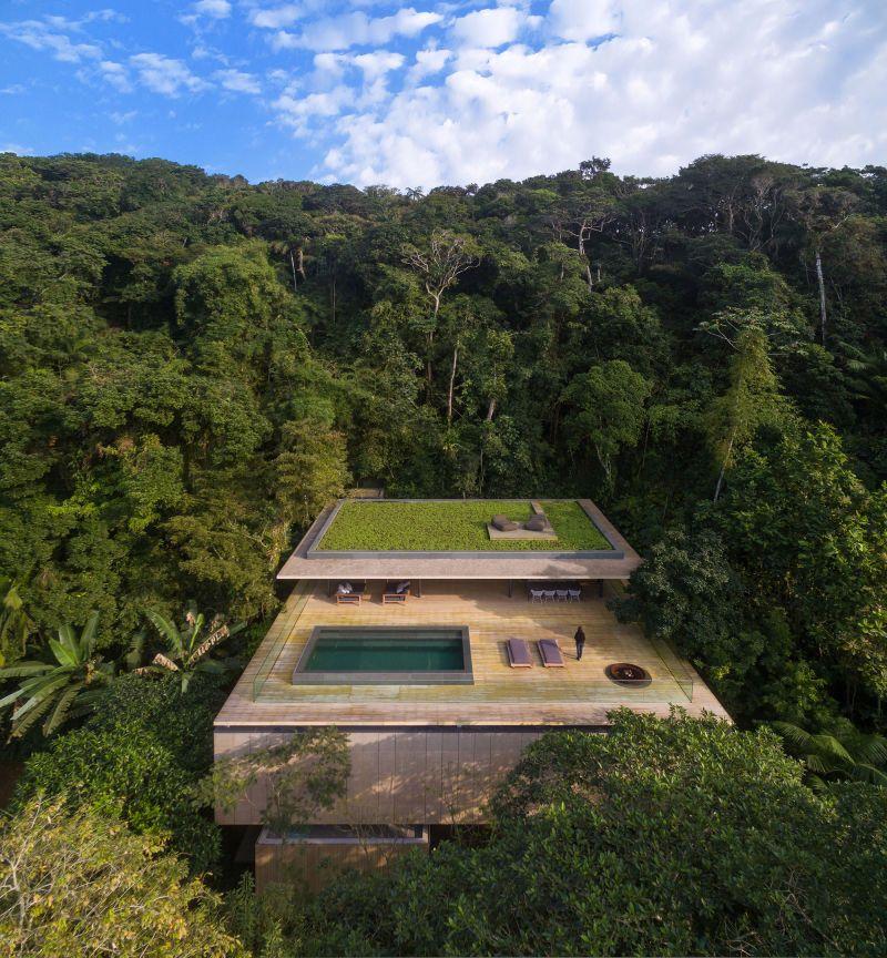 Casa na Matau201c in Brasilien Architecture - eine feuerstelle am pool
