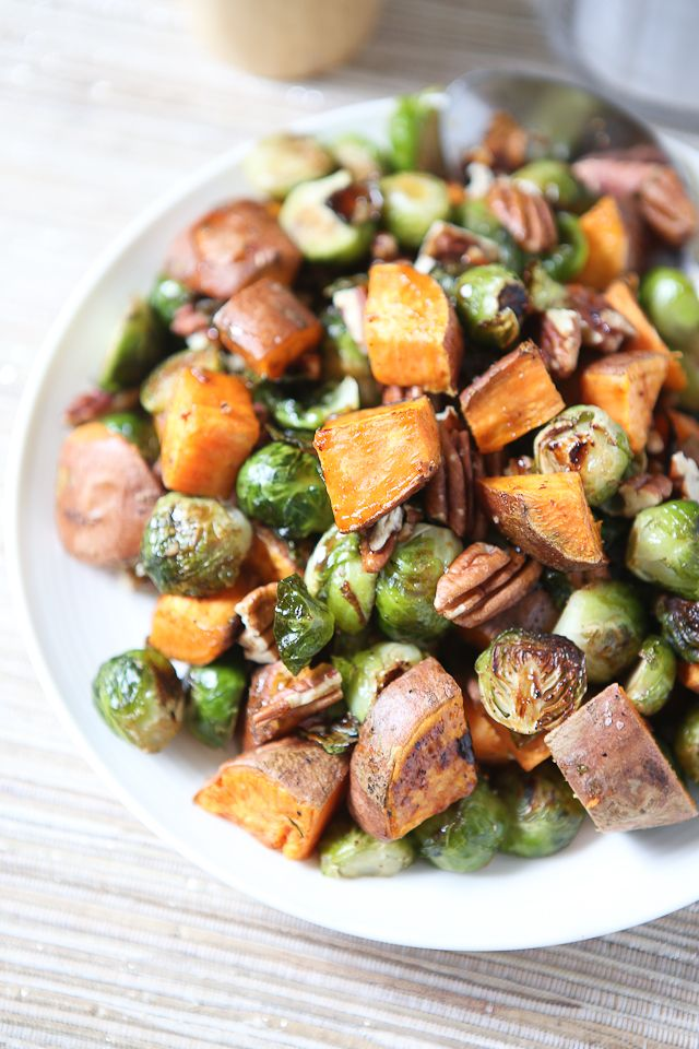 The flavors of fall on a plate - you'll love serving these Roasted Sweet Potatoes and Brussels Sprouts with Pecans to your guests this holiday season.