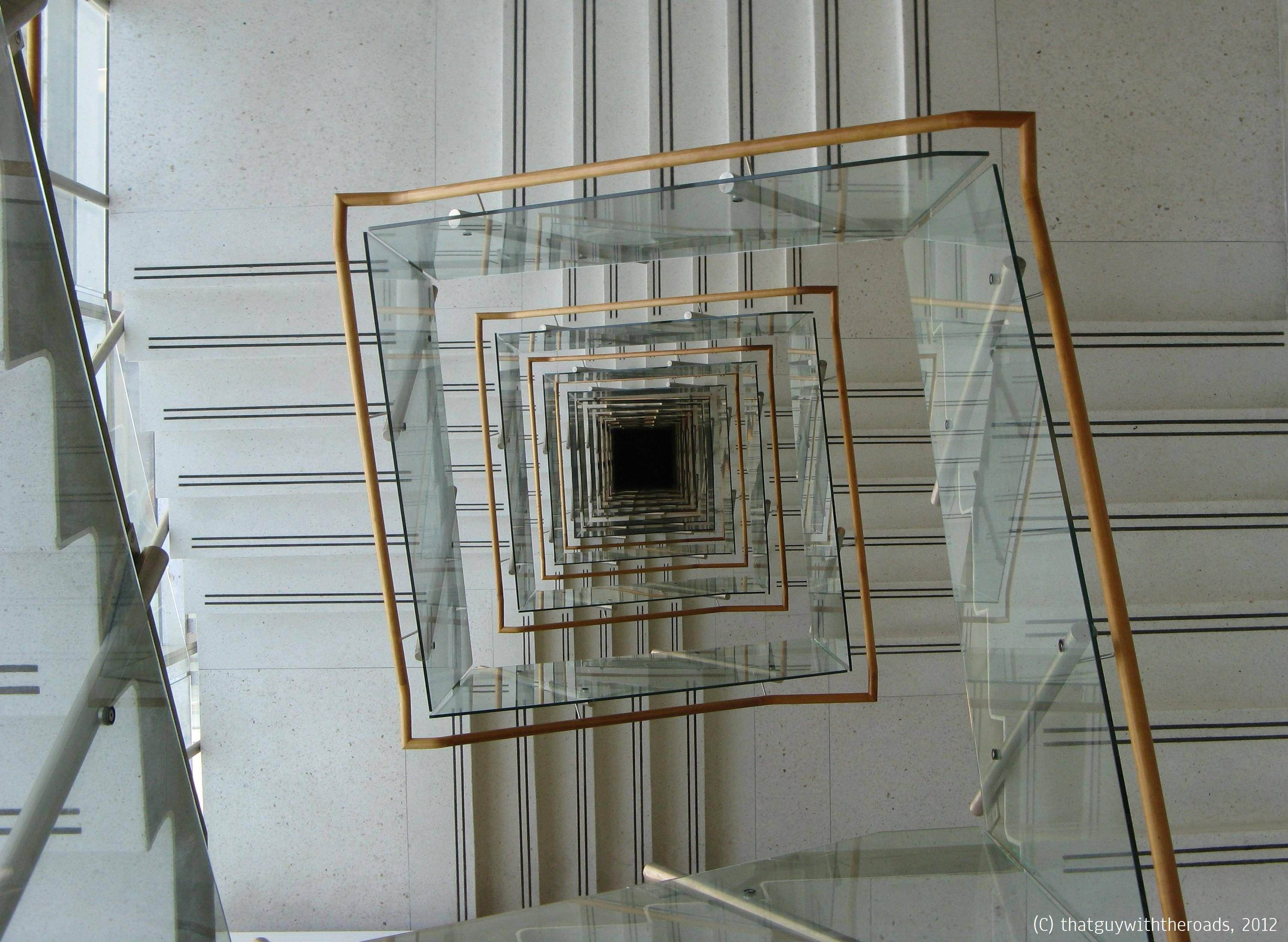 Dazzling square spiral staircase with clear glass and also for Square spiral staircase plans hall