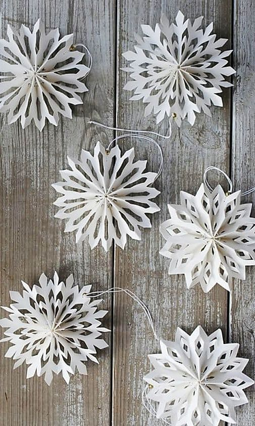 Nine Ways To Take Paper Snowflakes To The Next Level Diy Christmas Snowflakes Christmas Snowflakes Paper Snowflake Patterns