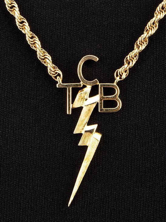 Elvis presleys personally worn tcb pendant necklace featuring a 14k elvis presleys personally worn tcb pendant necklace featuring a 14k yellow gold pendant designed as a lightening bolt surmounted by the initials tc mozeypictures Image collections