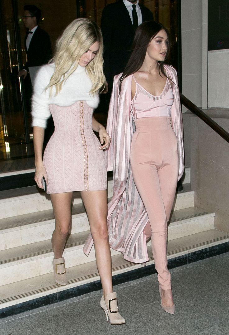 cc4fa649e91e Jenner stepped out with fellow model Gigi Hadid in matching blush Balmain  looks and swapped hair colors.