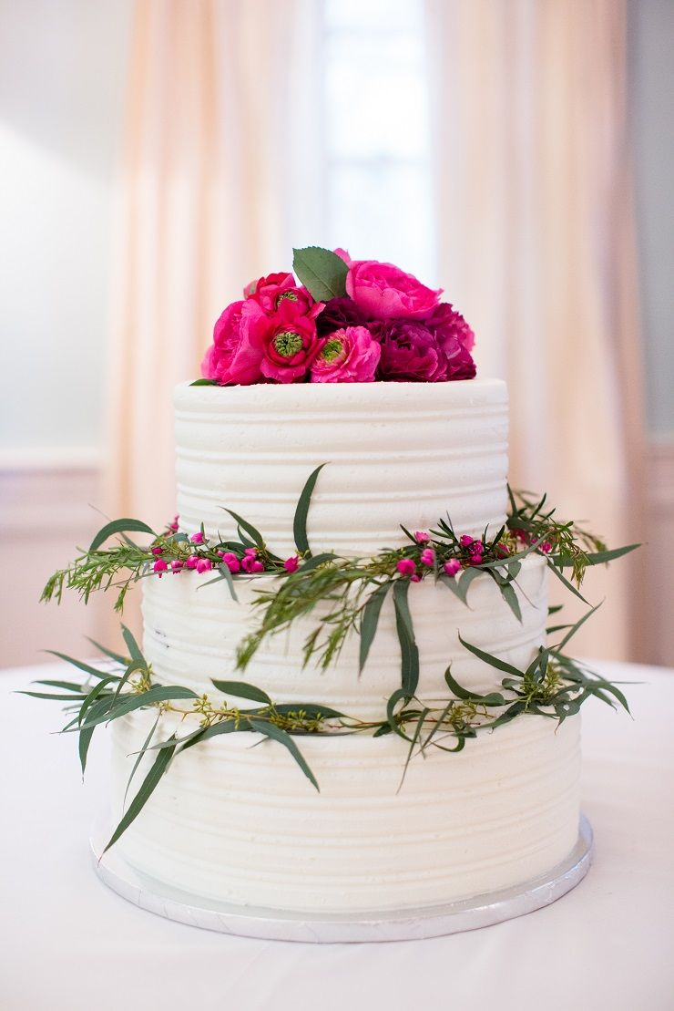 Wedding Cake topped with bright pink flowers | fabmood.com