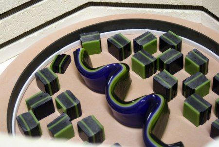 a blending of fused glass techniques flow bar and patterns