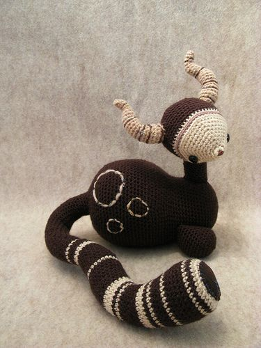 "Sepia Amigurumi Monster Cat Cow Thing- split between two thoughts here: ""wtf"", and ""i need this pattern immediately"""