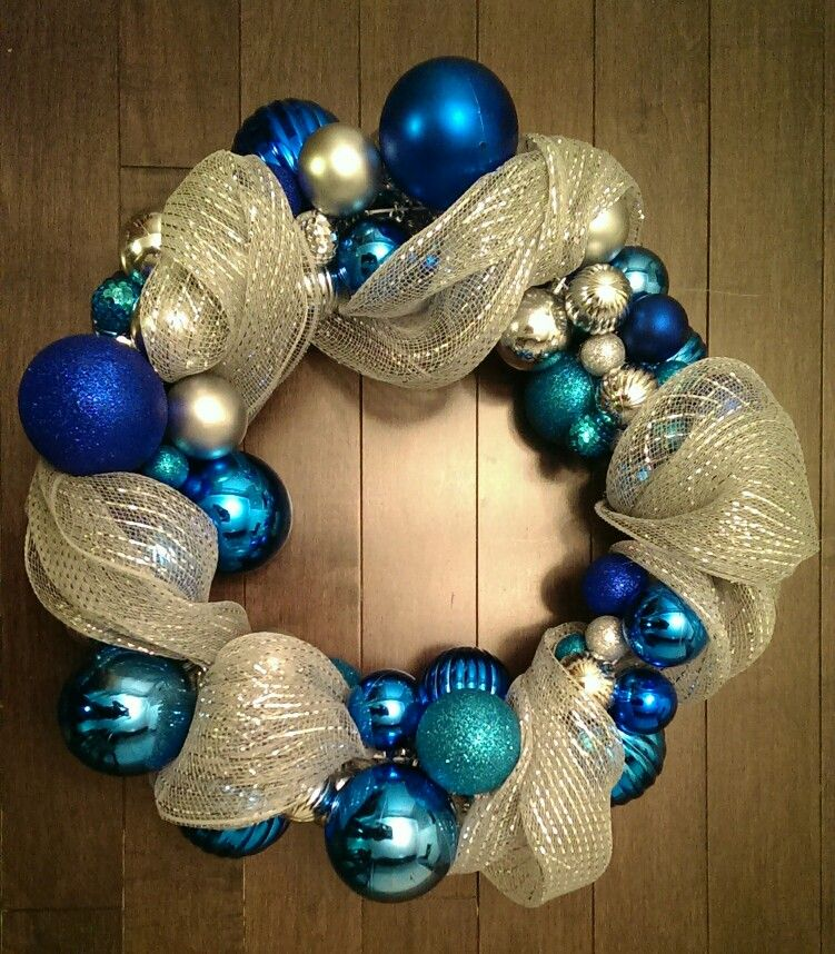 DIY wreath made from a wire coat hanger and lots of