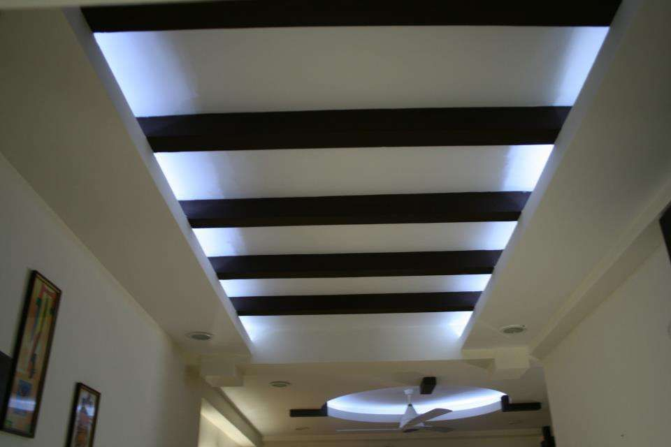 A unique combination of contemporary decor with for Bedroom false ceiling designs with wood