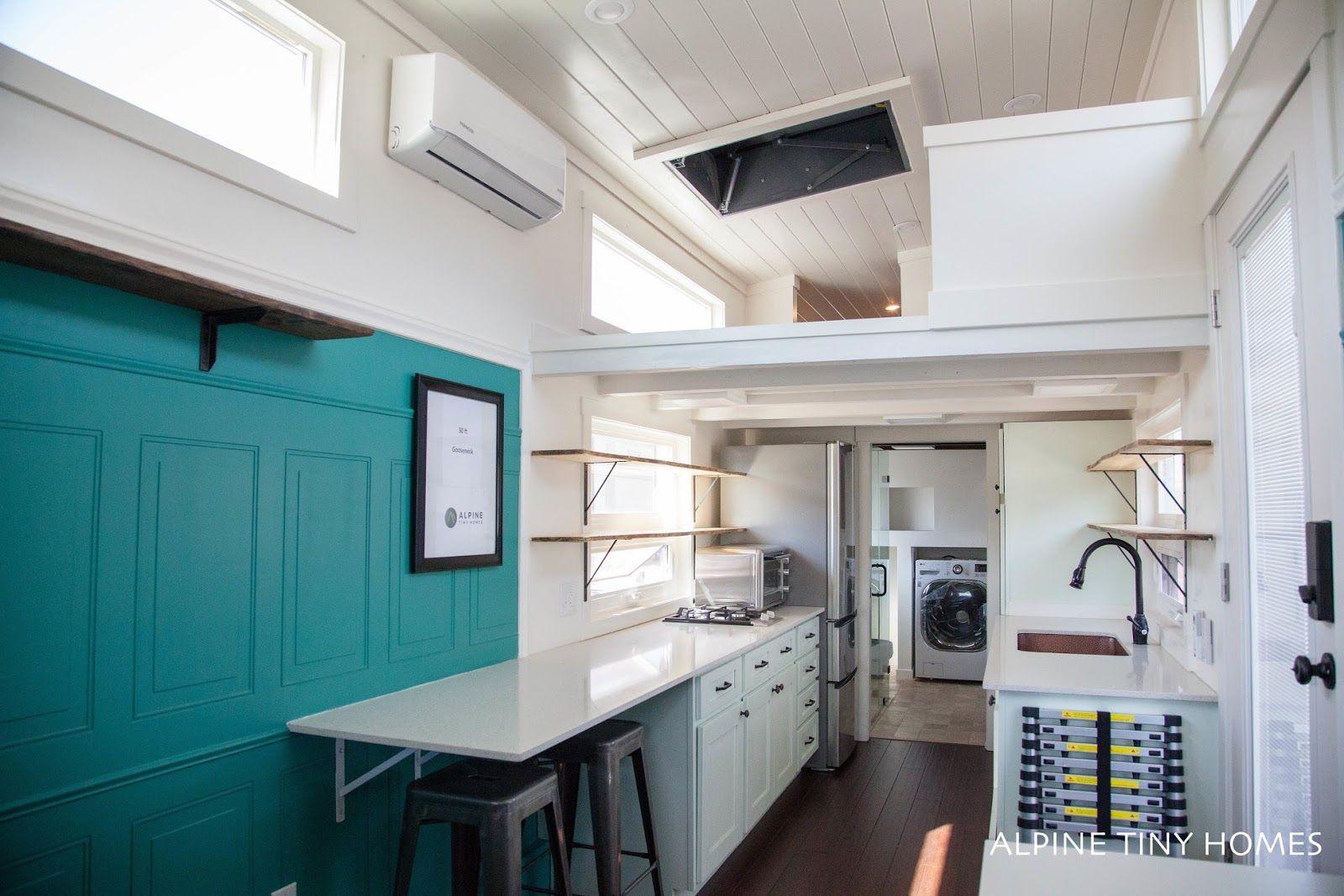 A tiny house built onto a 30\' gooseneck trailer by Alpine Tiny Homes ...