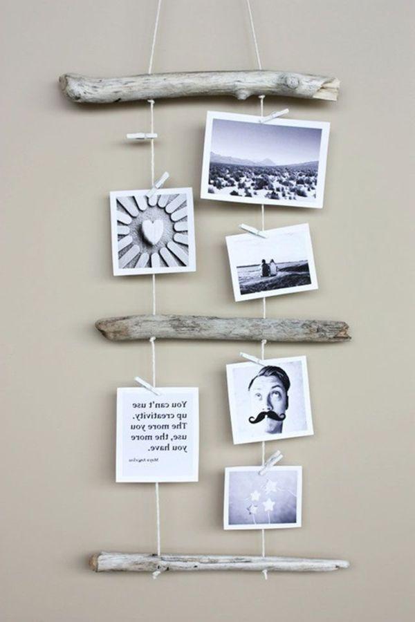 Hängende Wanddeko hängende fotos und stöcke aus holz als wanddekoration - zeit für