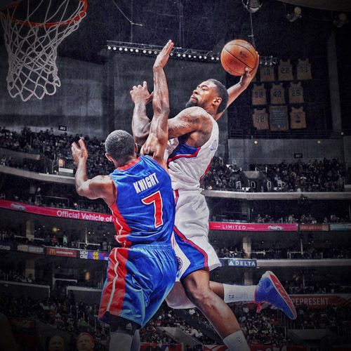 Knight Basketball Player Wallpaper: DeAndre Jordan Monster-Alley Oop Over Brandon Knight