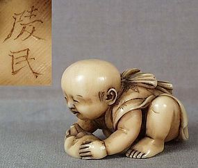 BOY by RYOMIN ex Mittleman Collection // 19th century ivory netsuke of a crawling baby boy wearing an apron and holding a Hyottoko (perplexed peasant) mask in his hands.