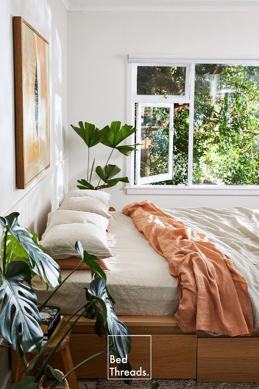 Photo of Oatmeal & Terracotta Linen Inside An Airy Coastal Bedroom