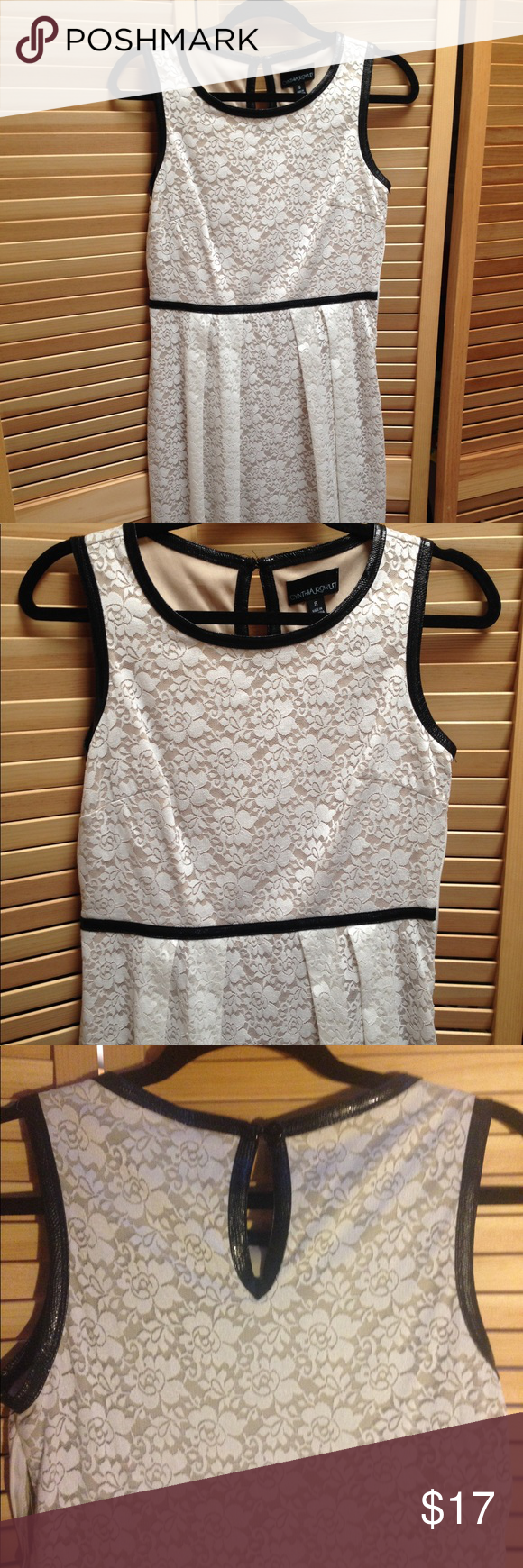 Lace below knee dress  Lace dress Really cute white lace dress with a touch of black