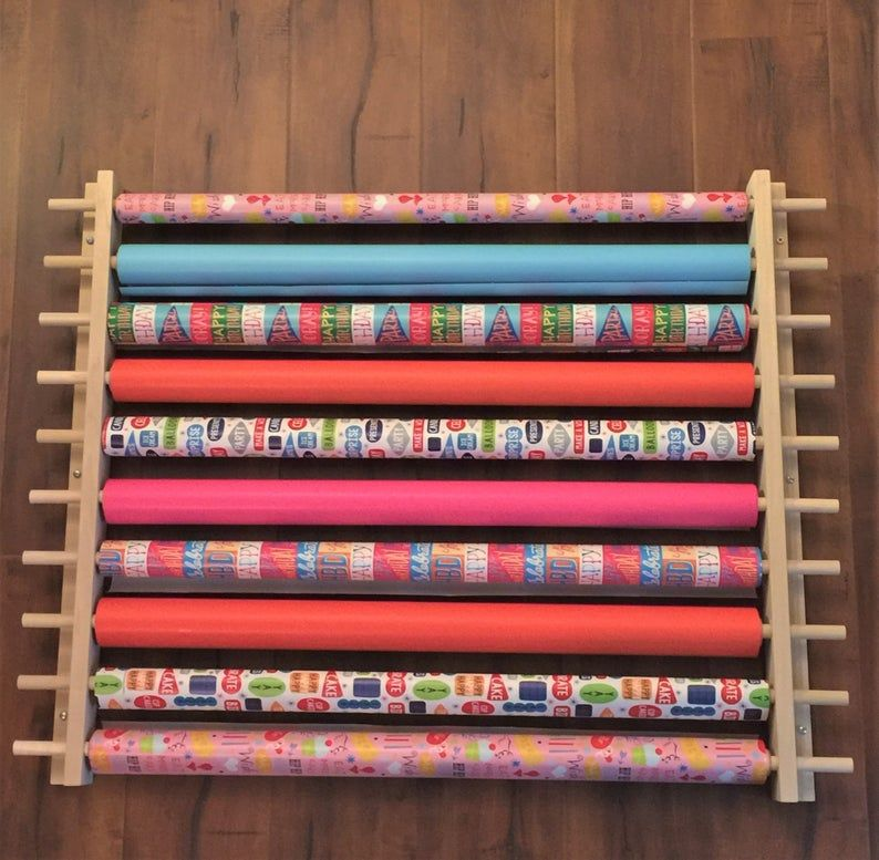 Gift wrapping paper station organizer also for ribbon