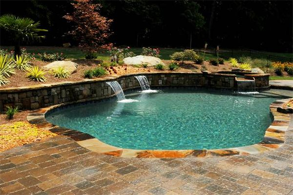 How To Build A Pool What To Do With A Sloped Backyard Backyard Pool Landscaping Sloped Backyard Backyard Pool Designs