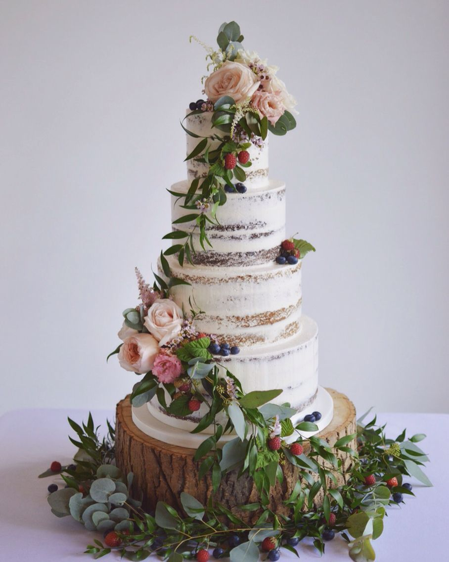 Semi naked cake with cascading foliage, berries and fresh flowers ...