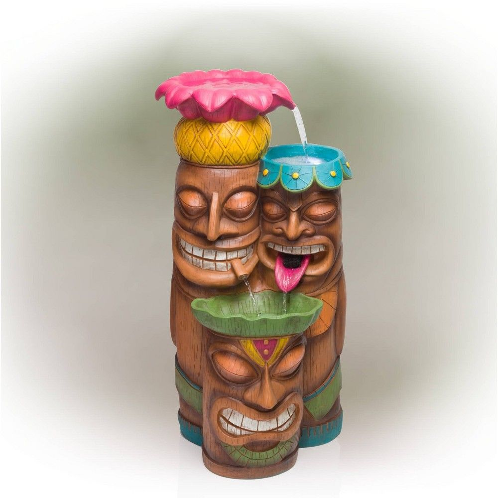 Add a touch of island fun to your outdoor space with the Alpine Corporation Colorful Tiki Head Fountain. Guests will be serenaded by the cascading streams and will feel like they are in the middle of the beach in Hawaii next to a tiki bar! This outdoor fountain looks great in your garden, patio, deck, porch, or yard space. Enjoy the sound of trickling water that pours from the mouths and rounded bowls sitting atop three levels of tiki totem heads. The polyresin, stone powder, and fiberglass cons