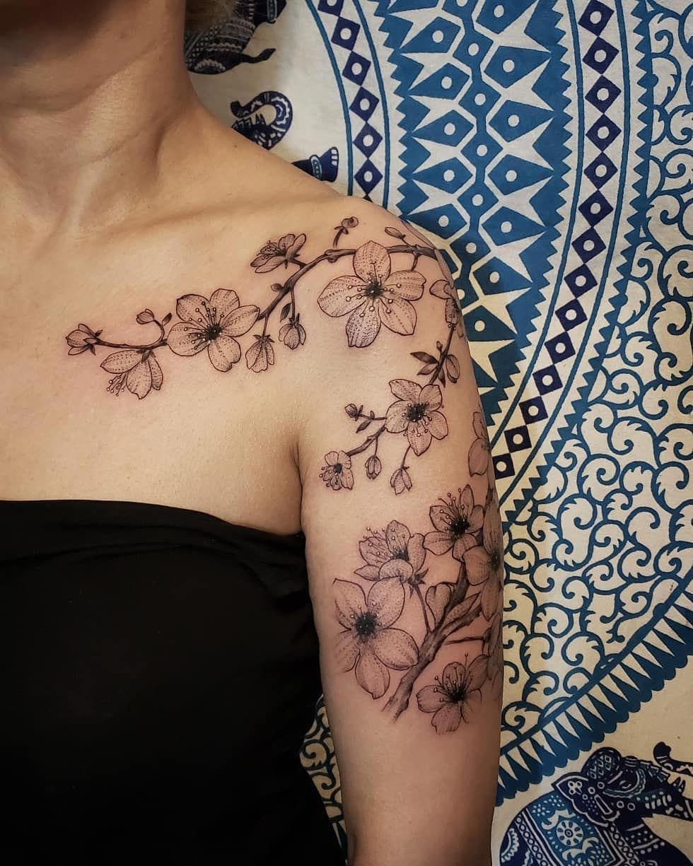Outstanding Tattoos Designs Are Available On Our Website Look At This And You Wont Be Sorry You Di In 2020 Cherry Blossom Tattoo Shoulder Blossom Tattoo Vine Tattoos