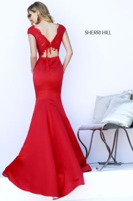 Simple front with a stunning back. Sherri Hill 32029