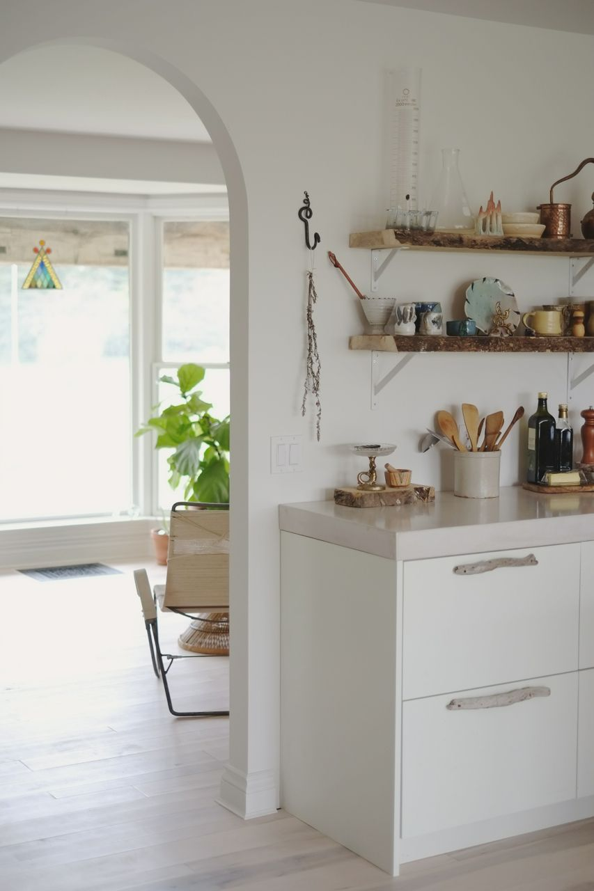 White washed kitchen cabinets with drift wood handles live edge