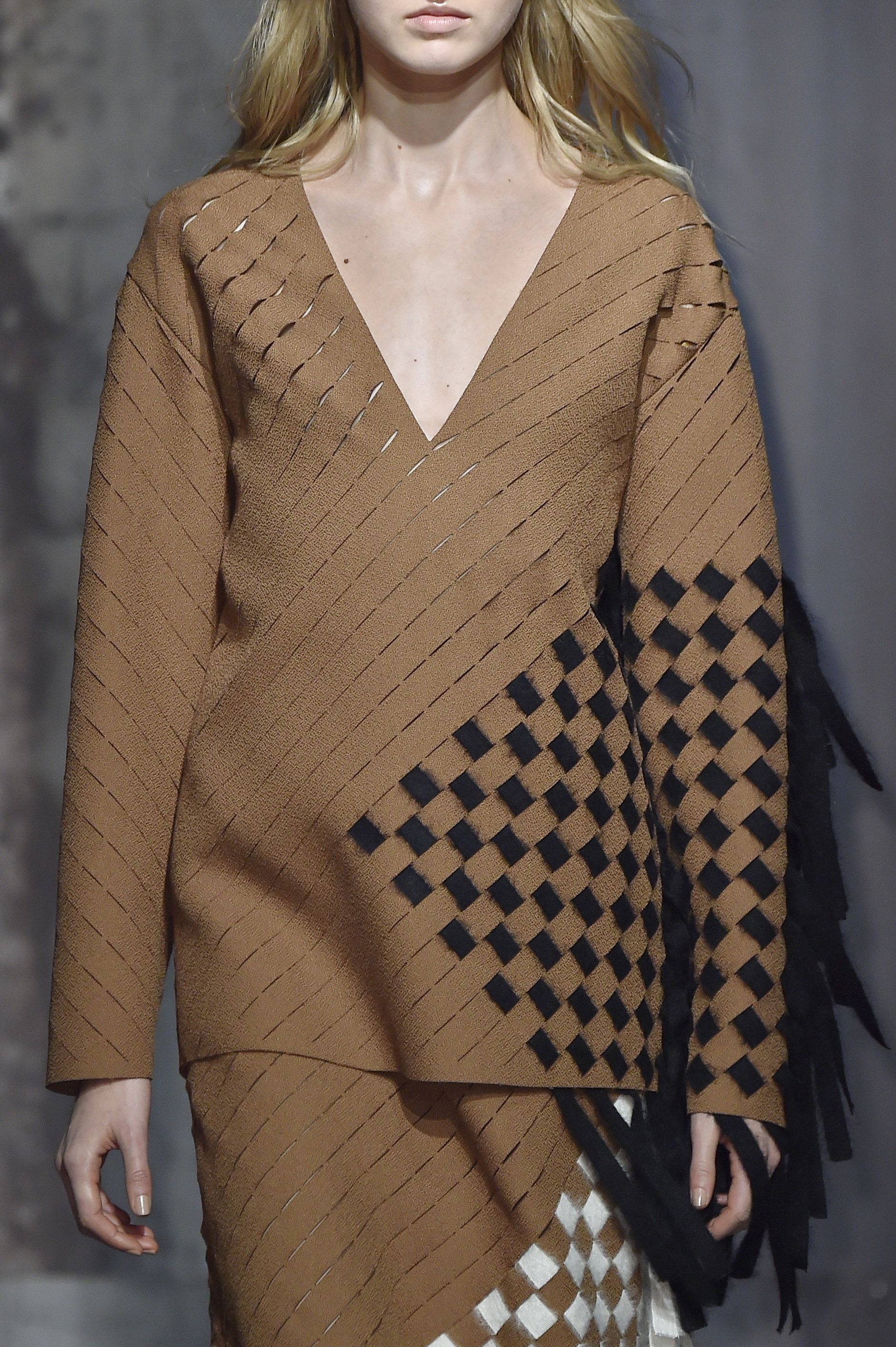 Intricate braiding details lend a modern sporty vibe at @marcodevincenzo #AW15 #MFW