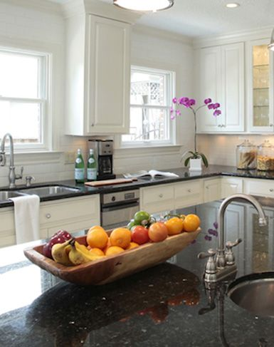 countertop fruit storage for a long or large island arrange colorful fruit in long vessel on kitchen decor pitchers carafes id=90274