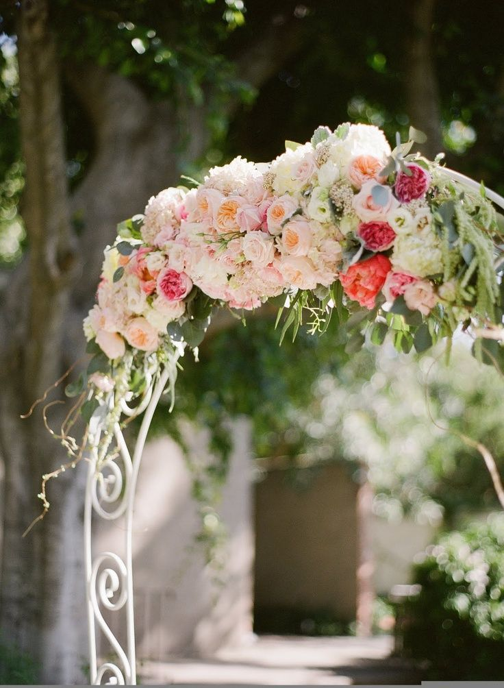 White arch of pastel flowers wedding ceremony flowers for Pastel colored flower arrangements
