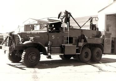 Post-WWII crash-rigs (firetrucks for airplanes) at Lowry AFB.