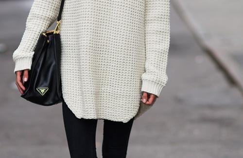 Black bag, tight black jeans, big knit