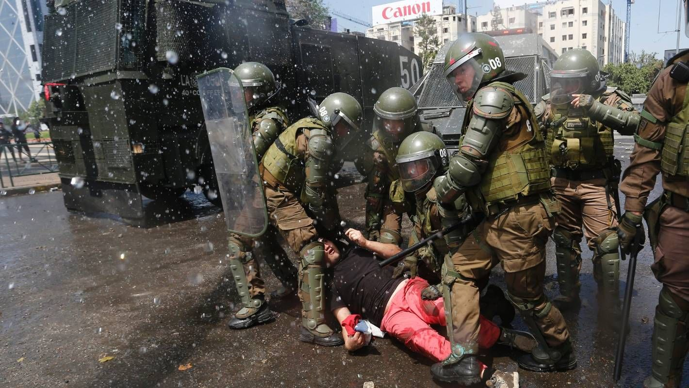 Chilean open fire on own civilians as protests of