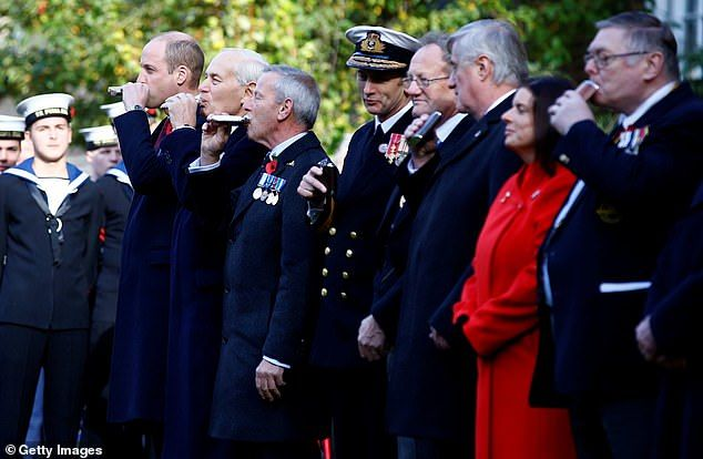 Attendees At The Remembrance Service Toast Absent Friends With A Swig From Their Hip Flask