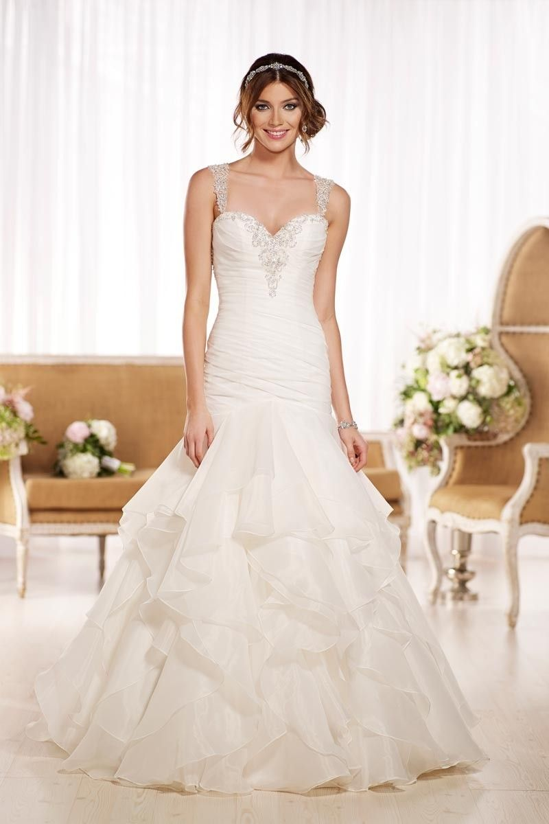 Leave your fiance(e) breathless in this fit-and-flare @essensedesigns wedding dress with a jeweled bodice and elegant straps!