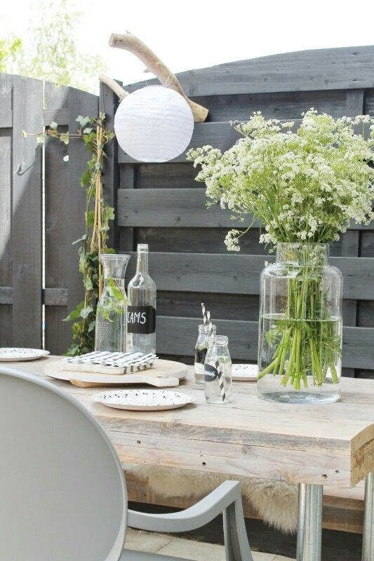 Storing water in pretty glass bottles instead of plastic bottles, provides a personalized touch to your table spread.